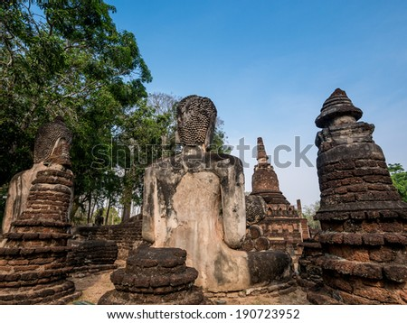 Back of broken ancient Buddha at Kamphaengphet Historical Park, Thailand - stock photo