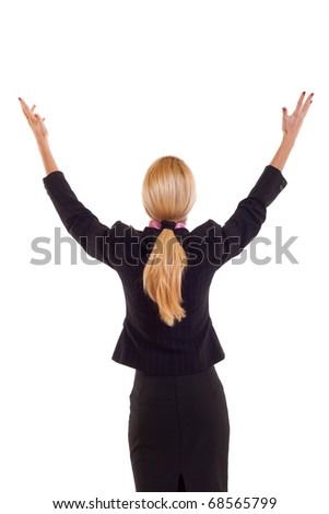 Back of business woman in black suit holding her hands in the air, isolated - stock photo