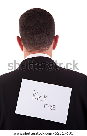 back of businessman, with kick me written in a paper , isolated on white background, studio shot. - stock photo