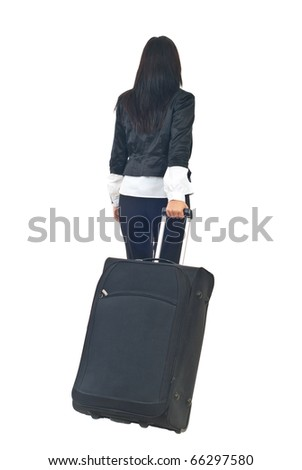 Back of businesswoman or stewardess going in a travel and carry luggage isolated on white background - stock photo