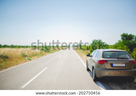 Back of car on a long and straight road in Croatia