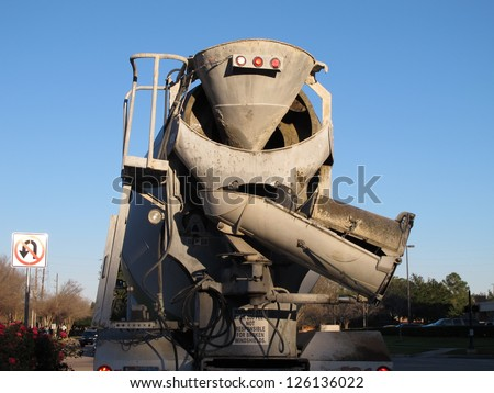 Back of cement truck with Warning Stay Back sign