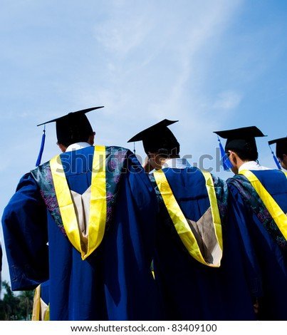 back of chinese graduates with blue sky - stock photo
