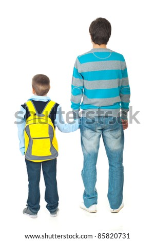 Back of father and son going to school isolated on white background - stock photo