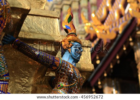 Back of Golden Angel (Ki-nara) in the Temple of Emerald Buddha (Wat Phra Kaew) at Grand Palace in Bangkok,Thailand.(This Temple is a public place in Bangkok)-Focus on Golden Angel and blur sanctuary - stock photo