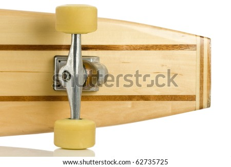Back of old wooden skate board - stock photo