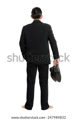 back of standing businessman on white background