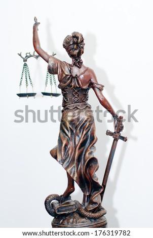 back of themis, femida or justice goddess sculpture on white - stock photo