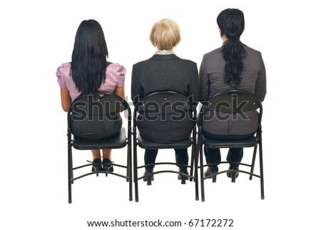 Back of three business women sitting on chairs at  presentation isolated on white background - stock photo