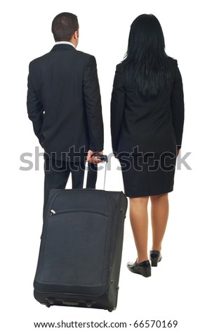 Back of two business people or steward and stewardess going to travel and holding luggage isolated on white background