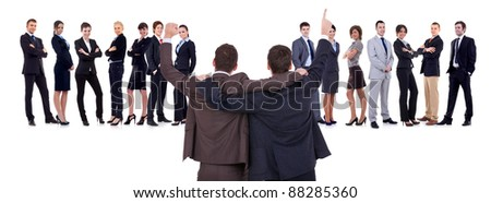 Back of two men leading a winning business team over white - stock photo