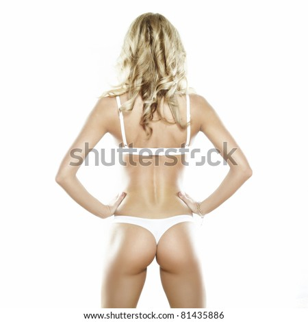 Back of young beautiful sexy blond lady in underwear on a white background.