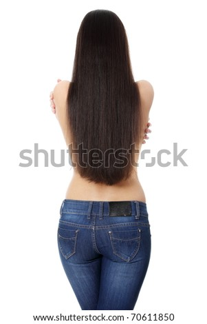 Back of young woman with long hairs, dressed in jeans. Isolated on white - stock photo