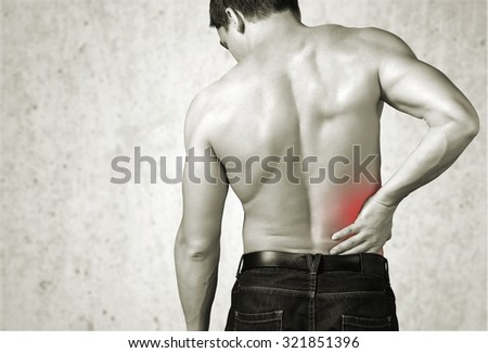 Back pain. - stock photo