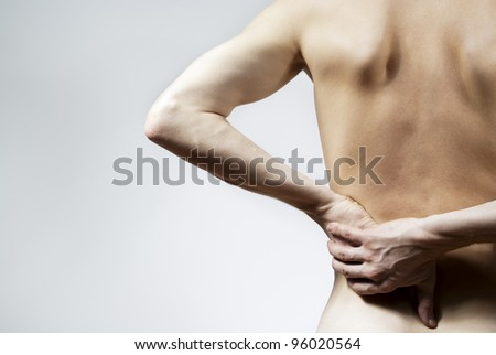 back pain on a grey background - stock photo