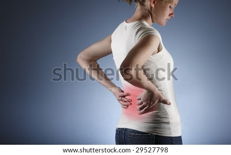 Back pain, woman - stock photo
