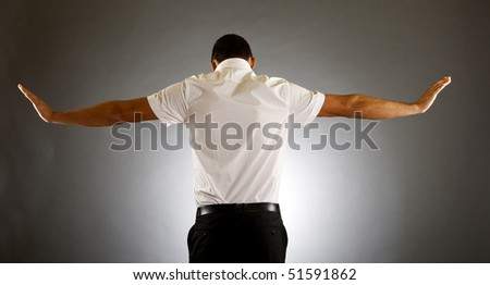 back picture of man with hands spread tot sides - stock photo