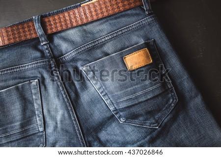 Back pocket of blue jeans with leather belt vintage color - stock photo