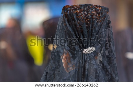 Back side of a woman with a comb in the Good Thursday during Holy Week in Valladolid.