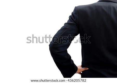 Back side of businessman in dark gray suit standing and akimbo looking forward to be success