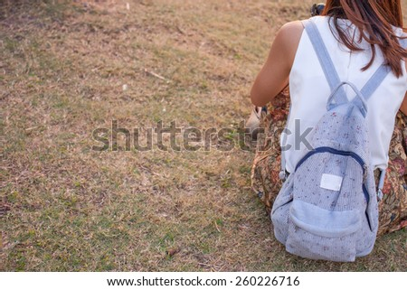 Back side of Lady with a backpack - stock photo