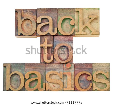 back to basics - fundamental principles concept -isolated text in vintage wood letterpress printing blocks stained by color inks