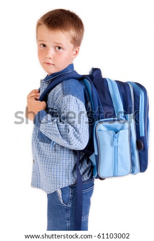 Back to school - a boy with a school bag - studio photo - isolated on white - stock photo
