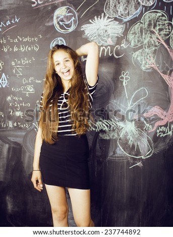 back to school after summer vacations, cute teen real girl in classroom - stock photo