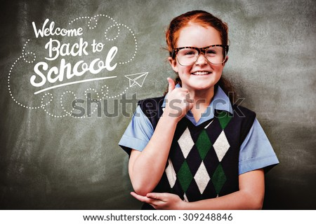 back to school against portrait of cute little girl gesturing thumbs up - stock photo