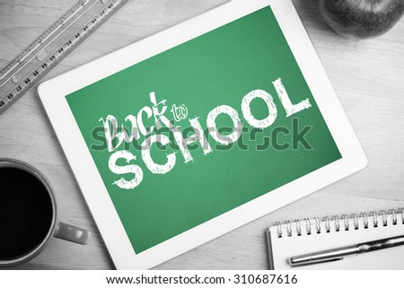 back to school against tablet on desk