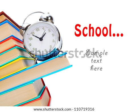 Back to school. An alarm clock and books. - stock photo