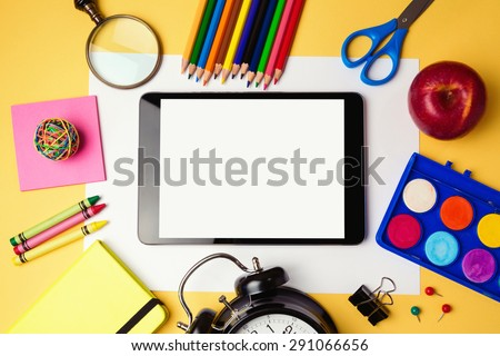 Back to school background with digital tablet and school supplies. View from above - stock photo