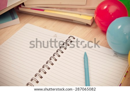 Back to school background with notebook and colorful ball, vintage tone - stock photo