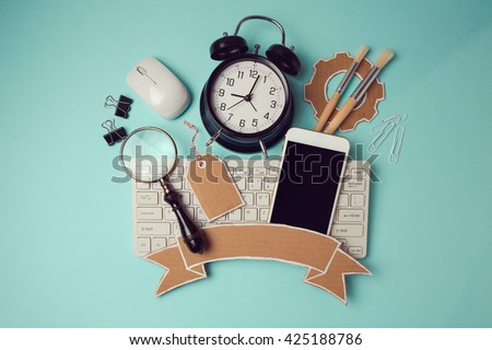 Back to school badge design with smartphone, keyboard and clock. Creative design hero header image. View from above. Flat lay - stock photo