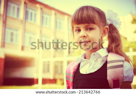 Back to school - beautiful small schoolgirl, education concept - stock photo