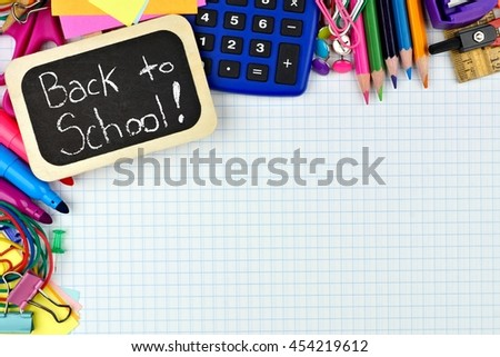 Back to School chalkboard tag with school supplies corner border on graphing paper background - stock photo