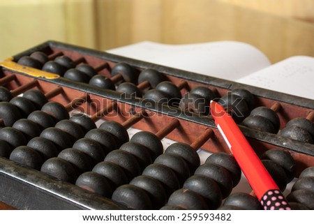 back to school concept abacus pen and textbooks - stock photo