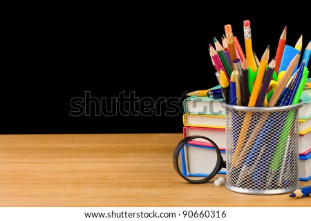 back to school concept and pile of books isolated on black background - stock photo