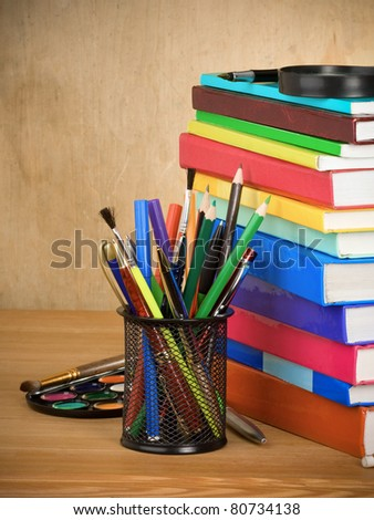 back to school concept and pile of books on wooden table