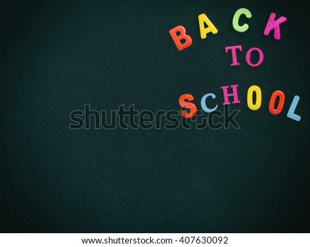Back to school concept - old dark chalkboard in classroom. - stock photo
