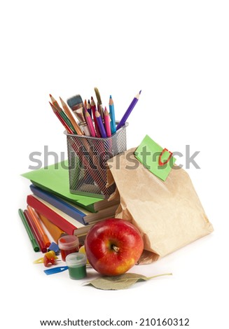 Back to School concept.School Books and apple isolated on white - stock photo