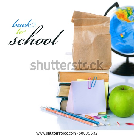 Back to School concept.School Books and green apple isolated on white - stock photo