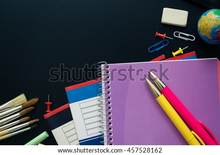 Back to school concept. School supplies on blackboard background. Back to school concept with stationery. Schoolchild and student studies accessories. Top view. - stock photo