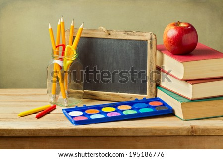 Back to school concept. School supplies on wooden table