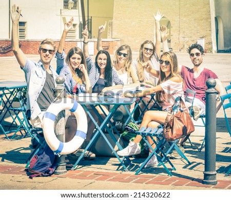 Back to school concept with a group of happy best friends - Tourists having fun in the summer around the old town - University students during a break in a sunny day - Vintage filtered look - stock photo