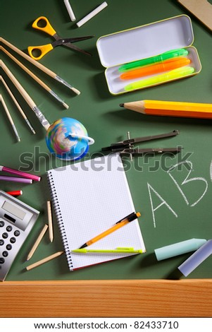 back to school concept with ABC written in green blackboard photo illustration - stock photo
