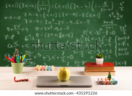 Back to school concept with long numbers calculation on blackboard and a desk with books, fruit - stock photo