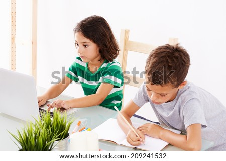Back to School. Couple of kids doing some homework - stock photo
