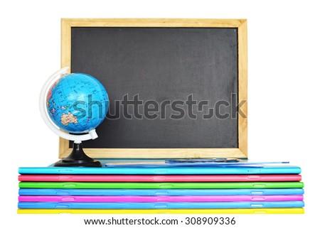 Back to school: Empty blackboard, notebooks and globe isolated on white background - stock photo