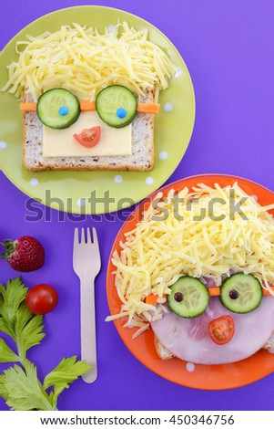 Back to school fun school lunch with happy faces sandwiches and healthy ingredients. - stock photo